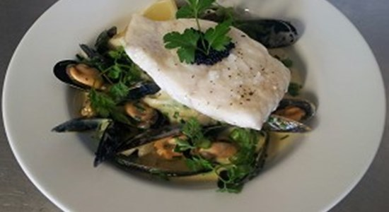 Steamed Halibut with a creamed mussel broth